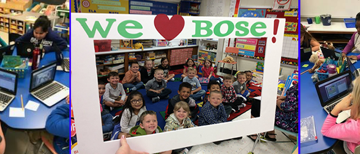 "Students holding a large frame that says ""we love Bose""."