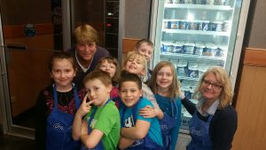 Beverly Degener and Janet Golm with a group of kids.