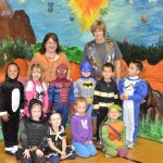 Denise Larson, Peggy Camp and Janice Caputo with students in Halloween costumes.