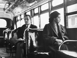People of different ethnic backgrounds on a bus during the civil rights movement