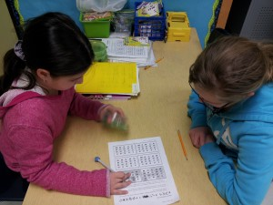 Two girls working on a math game.
